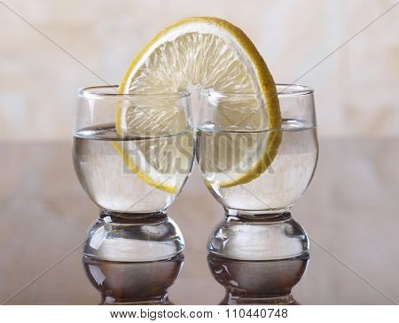 Glass cup with tequila on table