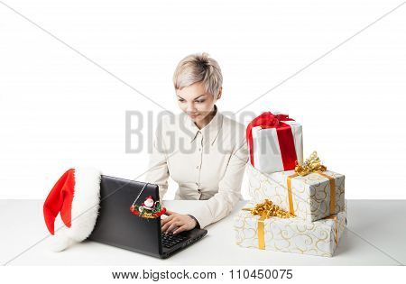 lady at desk with present boxes and hat over white