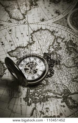 Vintage Antique Pocket Watch On Old Map Background