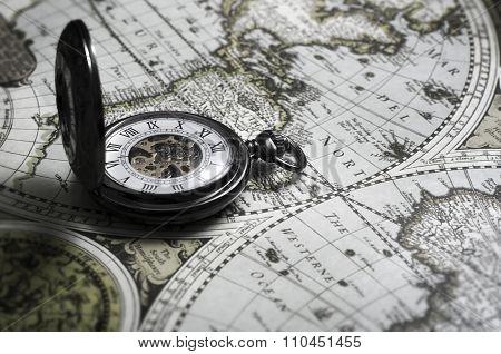 Vintage Antique Pocket Watch On Old Map Background
