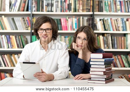 Man And Woman Studying And Working In The Library