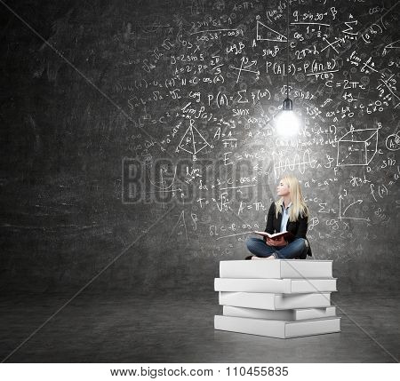 Woman Sitting On A Pile Of Book Thinking About Problem