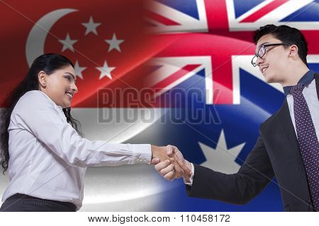 Singaporean Woman Shaking Hands With Australian Person