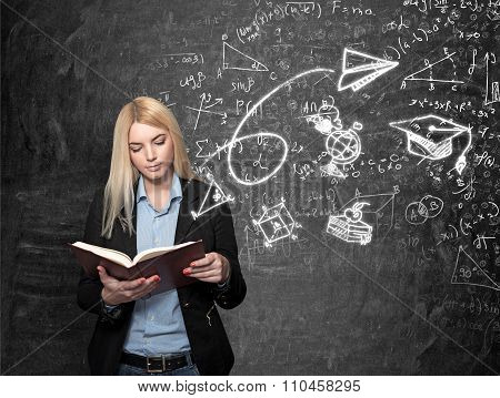 Young Girl Reading Blackboard With Science Icons At The Background