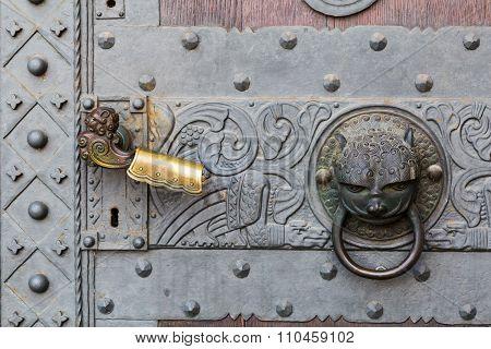 Detail Of Door With Handle And Knocker.