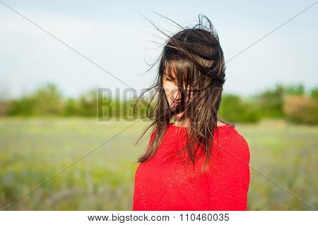 Shy Woman With Fluttering Hair.