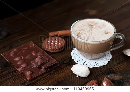 Cup Of Cappuccino And Chocolate Chip Cookies On A Dark Background