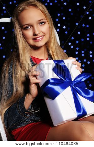 Festive Photo Of Cute Little Girl Whith Long Blond Hair Holding A Gift-box