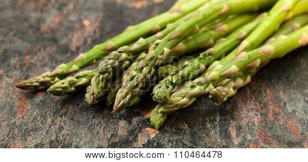 Fresh Asparagus On Natural Stone