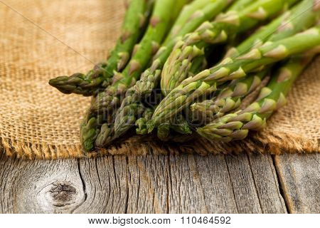Fresh Asparagus On Napkin And Rustic Wood