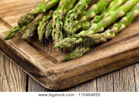 Fresh Asparagus On Rustic Wooden Server Board
