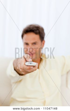 Close Up Of A Man Holding A Remote On The Sofa
