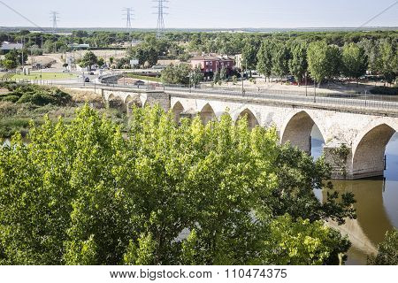 stone bridge over Duero river - Tordesillas, Valladolid, Spain