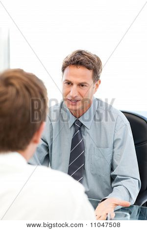 Serious Manager Talkin Witthh Anemployee During An Interview
