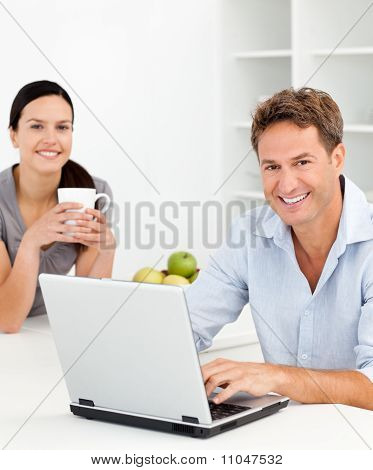 Portrait Of A Couple Relaxing Together In The Kitchen