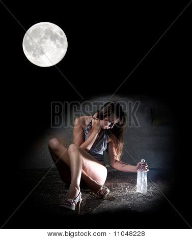 Drunk Girl With An Empty Vodka Bottle In Moonlight Night