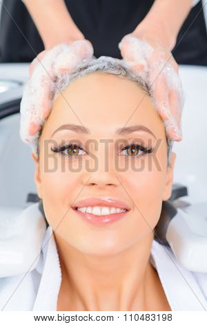 Client is enjoying washing procedure.