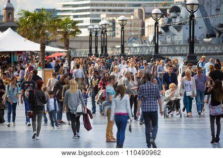 LONDON UK - SEPTEMBER 19, 2015 - Lots of people walking by river Thames. City of London in weekend