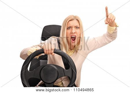 Angry woman pretending to drive and shouting towards the camera isolated on white background