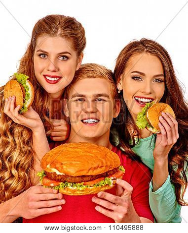 Group people holding hamburgers . Fast food concept. Happy handsome man on foreground. Isolated.