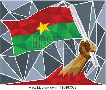 Powerful Hand Raising The Flag Of Burkina Faso