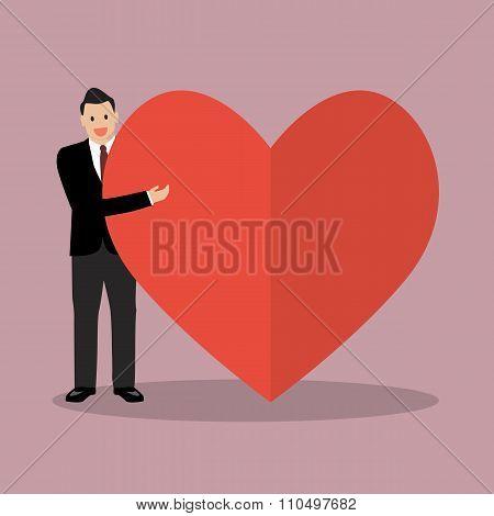 Businessman Presenting The Big Heart