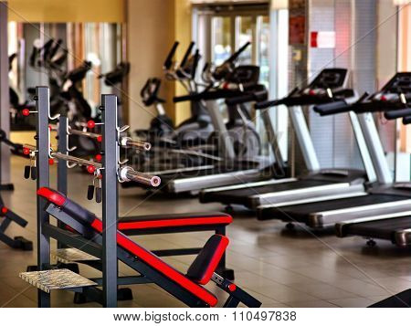 Sport gym interior with treadmill equipment.