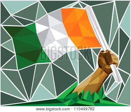 Patriotic Man Raising The National Flag Of Ivory Coast