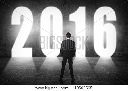 Business Man Walking To 2016 Number