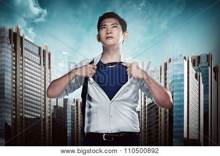 Asian Business Man Showing A Superhero Suit