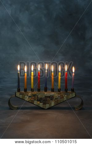 Hanukkah Menorah with burning candles on background