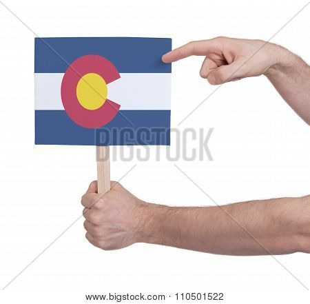 Hand Holding Small Card - Flag Of Colorado