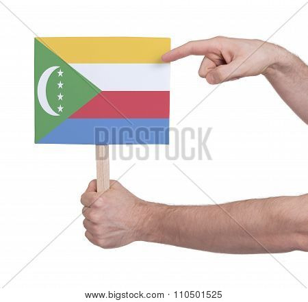 Hand Holding Small Card - Flag Of Comoros