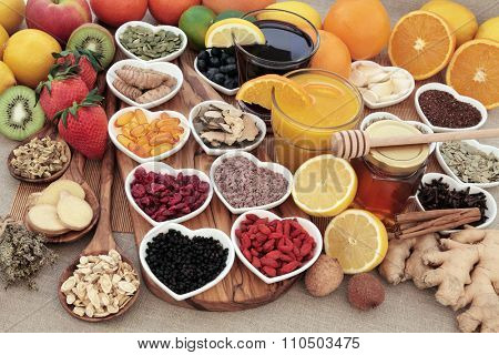 Healthy super food for cold remedy with fruit, orange and blackcurrant drinks, vitamin c supplement capsules, honey and medicinal herbs and spices, high in antioxidants.