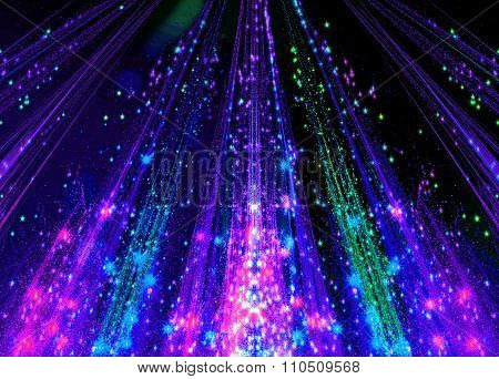 Abstraction with laser beams and flare sparks and the stars are shining in the darkness, colorful li
