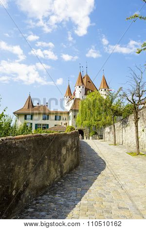 A Cobbled Road Leads To The Castle Of Thun