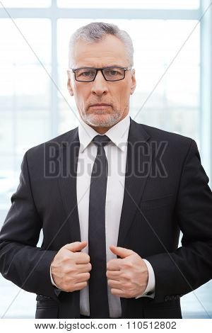 Aged businessman in white office