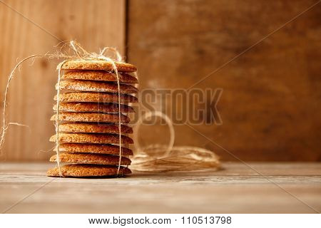 Stack Of Cookies Tied With Craft Rope On Wooden Table