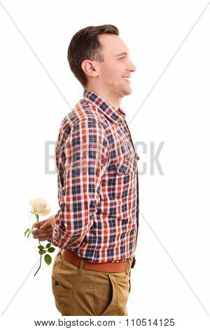 Smiling Young Man Hiding A Flower