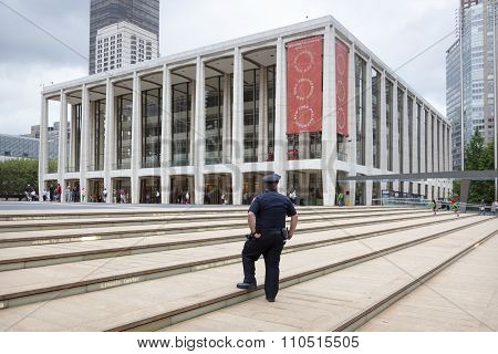 New York City, 12 September 2015: Police Officer Stands On Steps Of Lincoln Centre In New York City