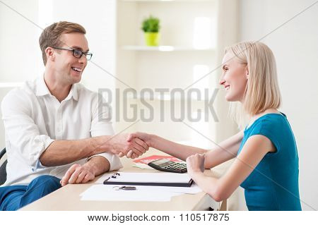 Cheerful estate agent and his female customer