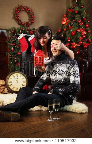 couple exchanging gifts at Christmas