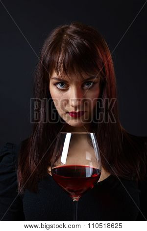 Young Beautiful Woman With Red Wine
