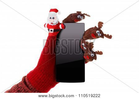 Christmas Concept Toy Santa Claus And Reindeer With A Gift In Hand Smartphone
