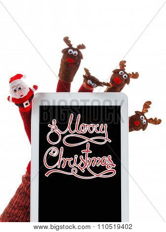 Christmas Concept Toy Santa Claus And Reindeer With A Gift In Hand Touchpad