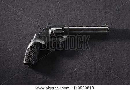 Revolver On Black Background