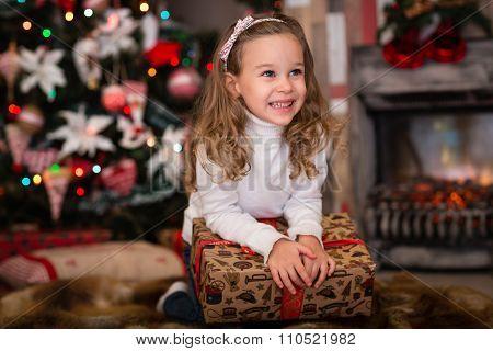 Happy Girl With Gift. Christmas.