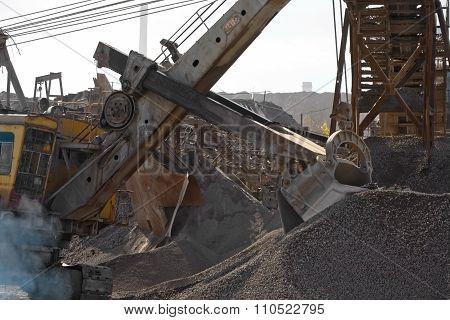 Excavator bucket gaining rubble