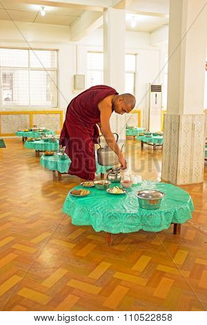 BAGO, MYANMAR -November 26, 2015: Monk serving tea in the monastery from Bago in Myanmar. Buddhism in Myanmar is predominantly of the Theravada tradition, practised by 89% of the country's population