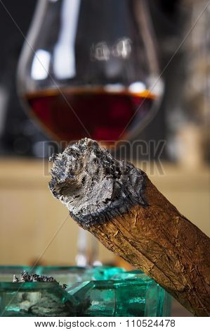 Cigar With Ashtray And Alcohol Drink In Background